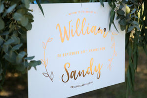 Close up of boho welcome wedding sign - rose gold and white