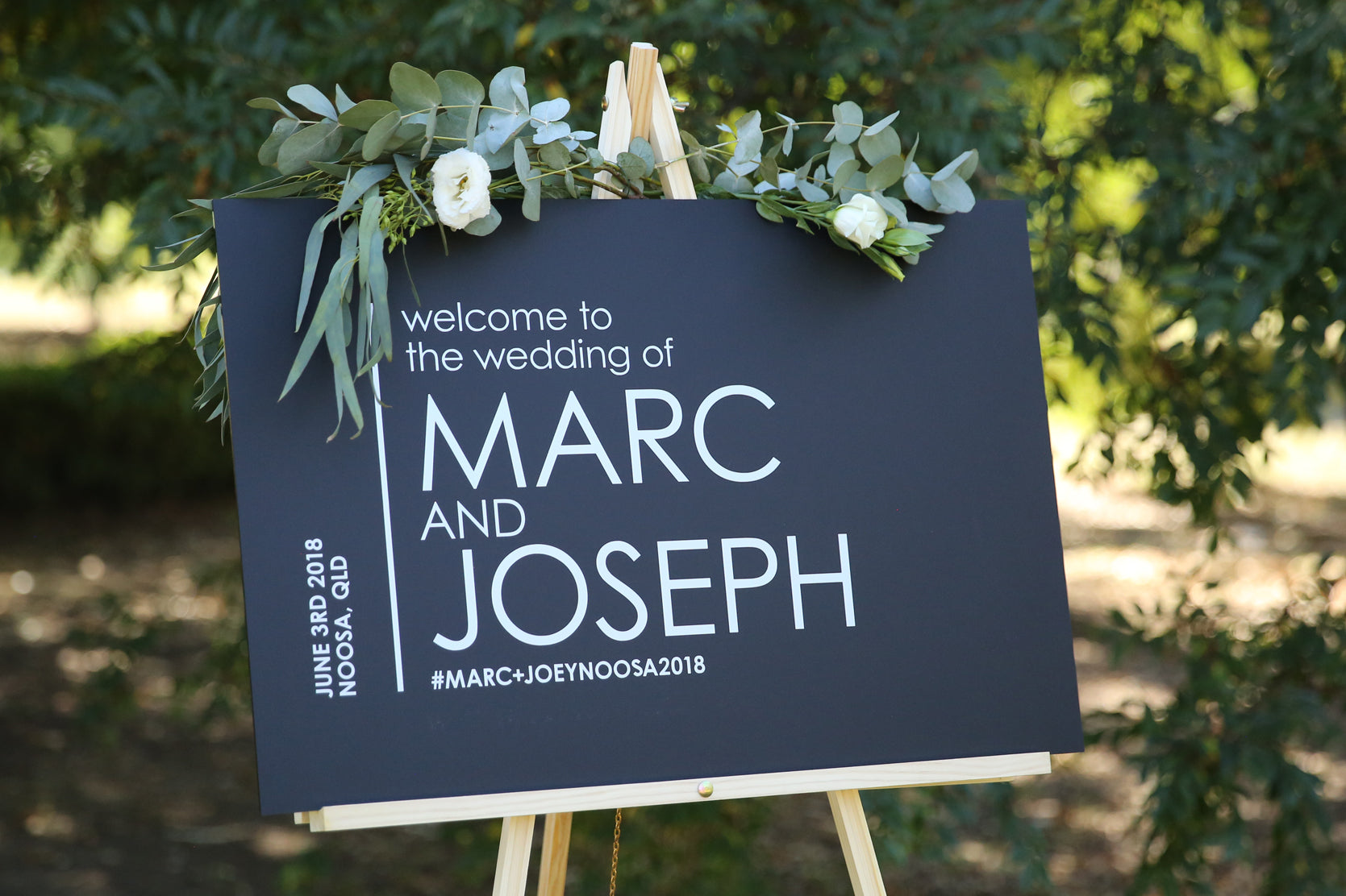 Wedding welcome sign, black and silver on easel
