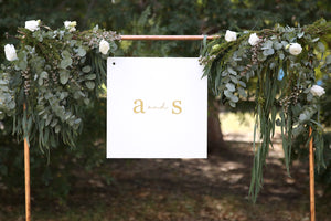 Timeless wedding sign hanging from copper pipe