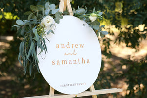Rose gold and white custom wedding sign on easel