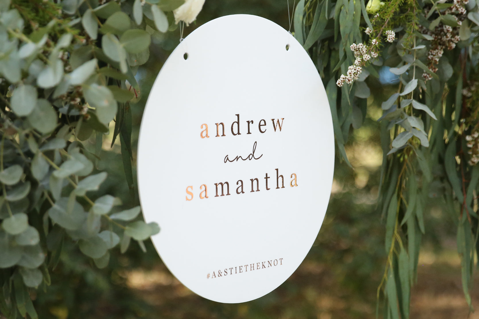Wedding sign hanging on flower wall, customise your sign