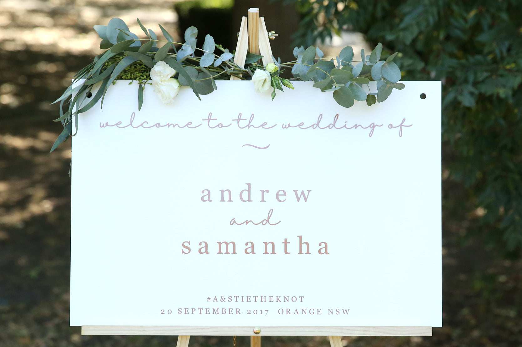 Simple script wedding welcome sign on easel