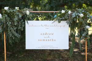 Welcome wedding sign hanging on copper pole