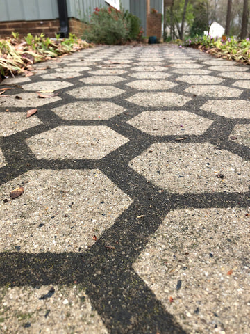 Close up of the Driveway Art CLT Hive Stencil that has been pressure washed.