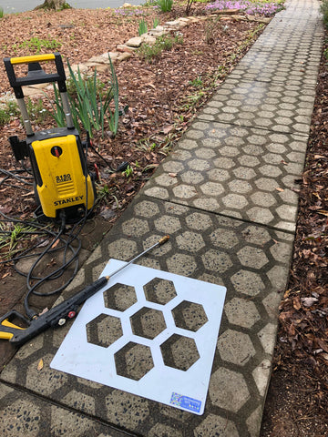 CLT Hive stencil, pressure washer and dirty walkway