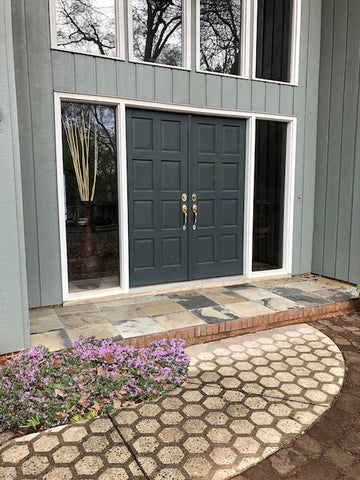 Modern Home with Driveway Art's CLT Hive design as a welcome mat.