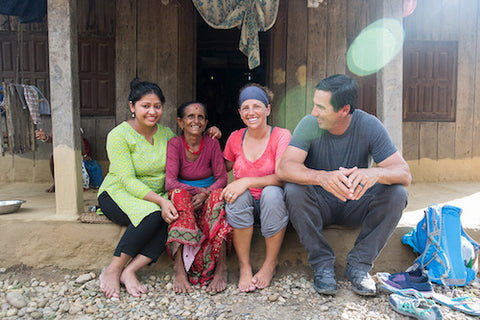 Wine to Water ambassadors sitting with a villager in Nepal.