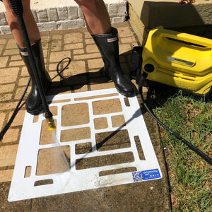 driveway art cobblestone stencil with a Karcher  pressure washer cleaning a dirty sidewalk