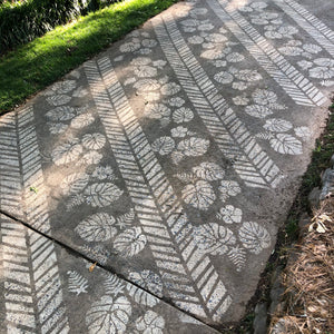 Chevron Pattern Pressure Washed onto a dirty driveway making a beautiful landscape.