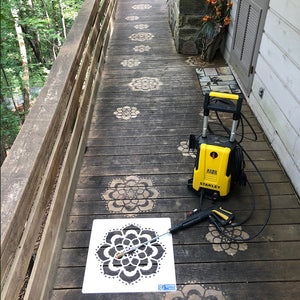 Mandala Stencil by Driveway Art® pressure washed onto the dirty walkway of a bungalow style home.