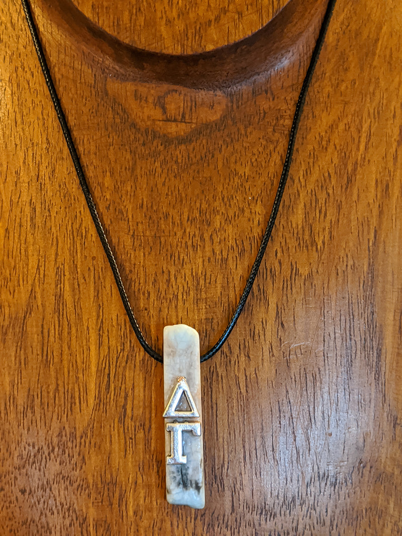 Delta Gamma Greek Letters on Adventurine, Black Cording - Hannah's Closet - The Official Boutique for Delta Gamma