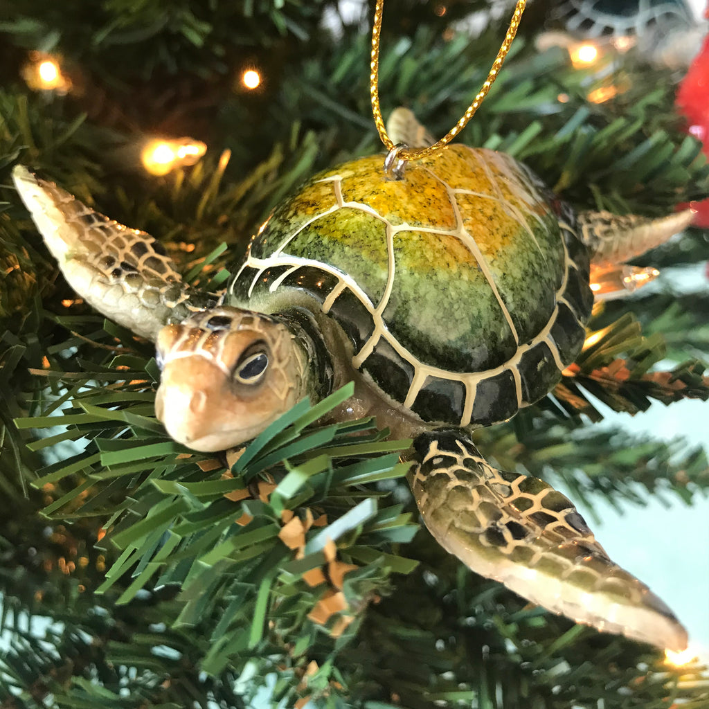 Green sea turtle ceramic ornament hanging on Christmas tree