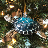 adorable hand-painted blue sea turtle ceramic ornament hanging on Christmas tree