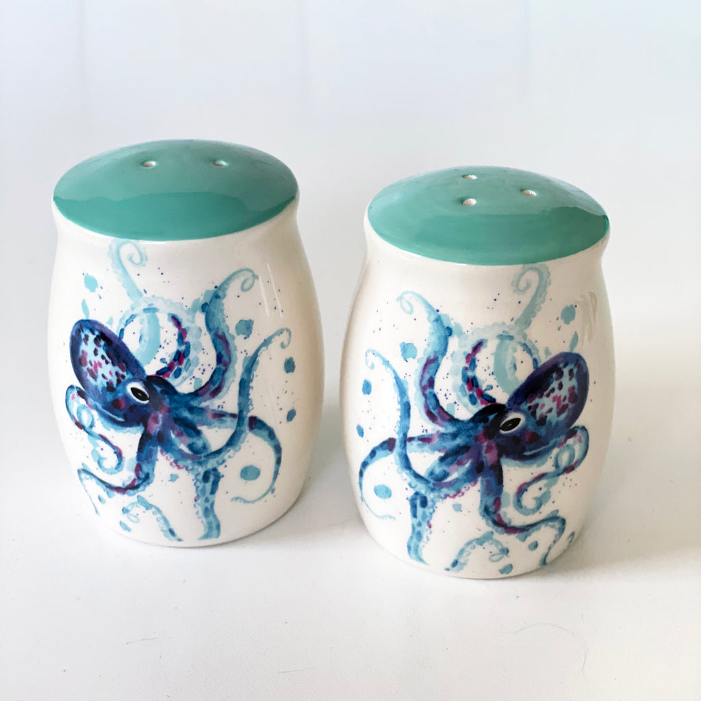 close up of octopus salt and pepper shakers on white background