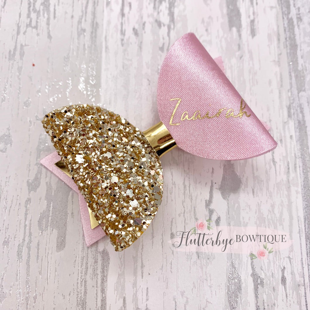Personalised Baby Pink Satin Bow, Gold Glitter Name Bow - Flutterbye Bowtique