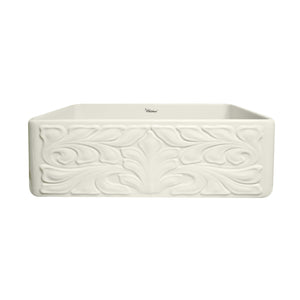 Whitehaus Farmhaus Fireclay Reversible Sink with a Gothichaus Swirl Design Front Apron on One Side, and a Fluted Front Apron on the Opposite Side.