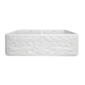 Whitehaus Farmhaus Fireclay Reversible Double Bowl Sink with a Gothichaus Swirl Design Front Apron on One Side, and a Fluted Front Apron on the Opposite Side.