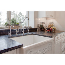 "Whitehaus Glencove St. Ives 33"" Front Apron Fireclay Sink with an Intricate Vine Design on one side and an Elegant Beveled Front Apron on the Opposite Side"
