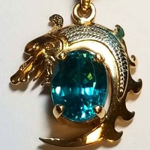 18k gold dragon pendant with natural blue zircon