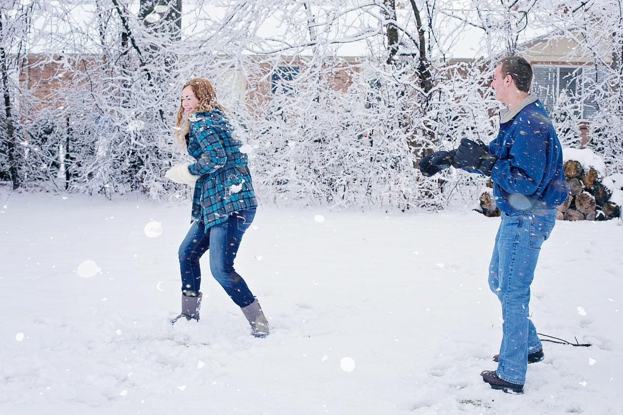 Snowball fight couple