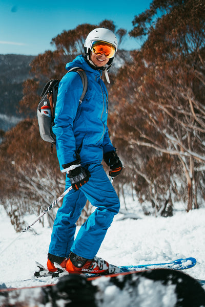 man wearing ski jacket and pants