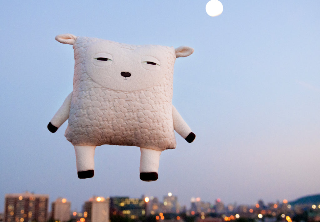Sheep pillow in the sky