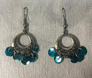 Circular blue sequin earrings