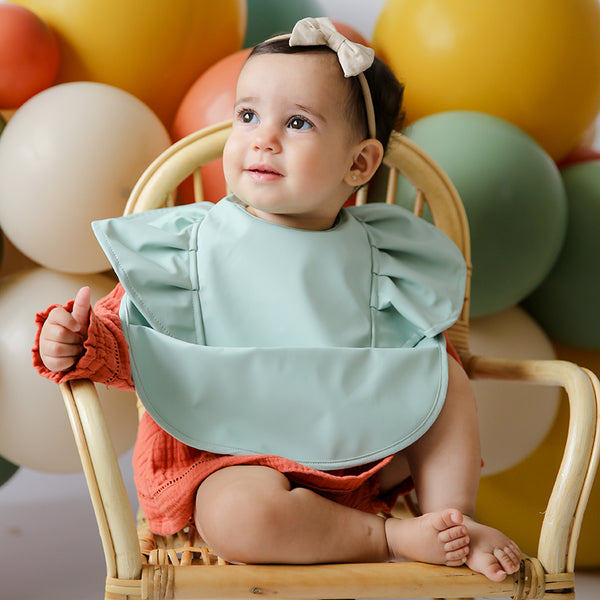 beautiful bubba wearing the sage frill snuggle bib by snuggle hunny kids