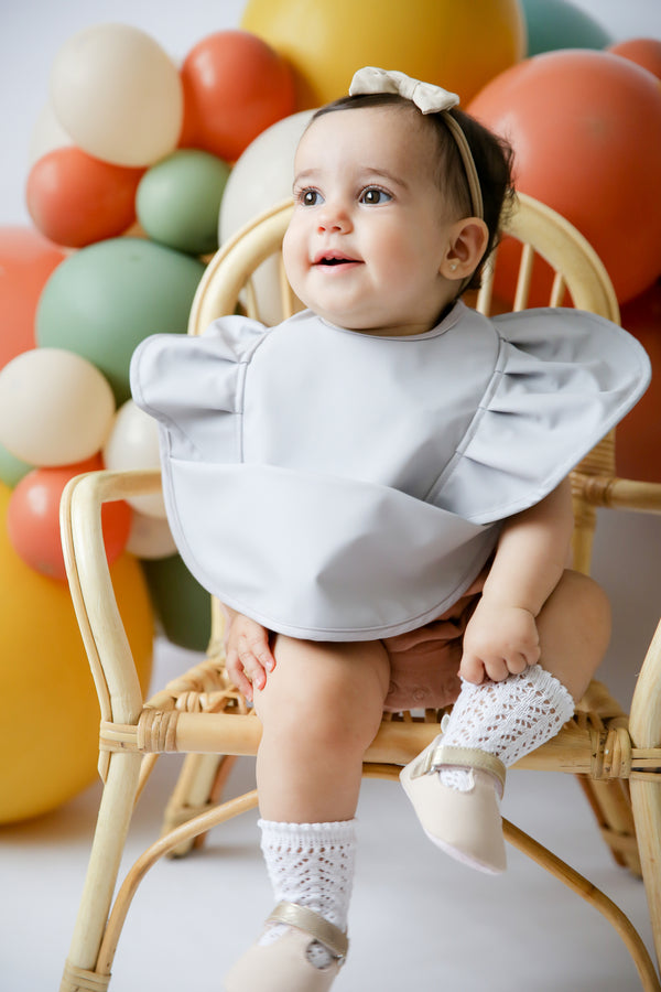 snuggle bib by snuggle hunny kids in dove grey frill