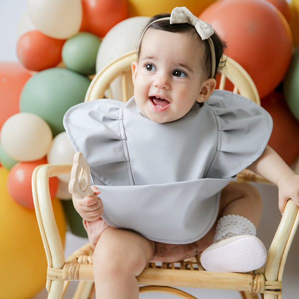 dove grey frill snuggle bib by snuggle hunny kids