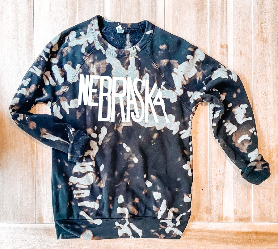 THE LEONARD CO ADULT NEBRASKA TIE DYE SWEATSHIRT | BLACK W/ WHITE LETTERING