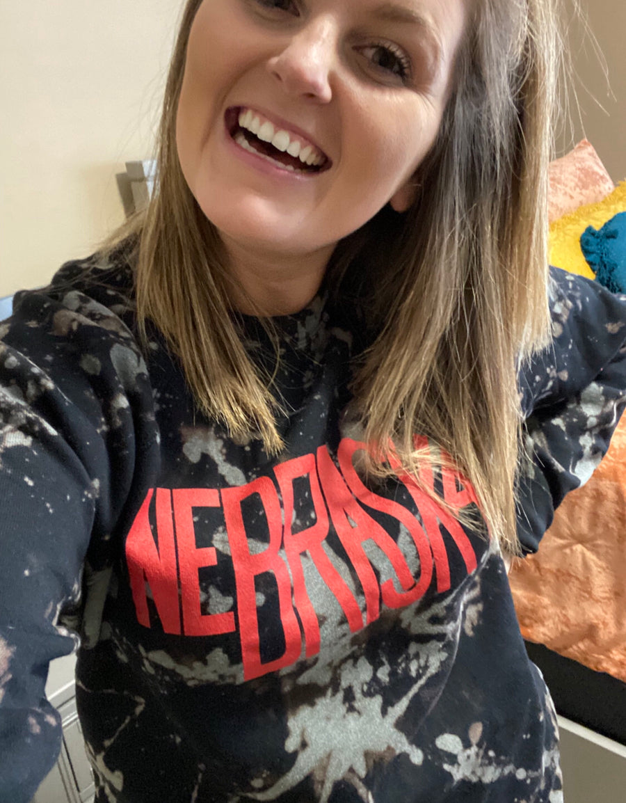 THE LEONARD CO ADULT NEBRASKA TIE DYE SWEATSHIRT | BLACK W/ RED LETTERING