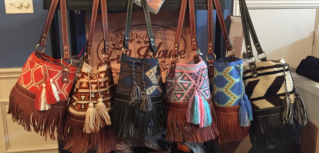 Leather and twill bucket bags with fringe