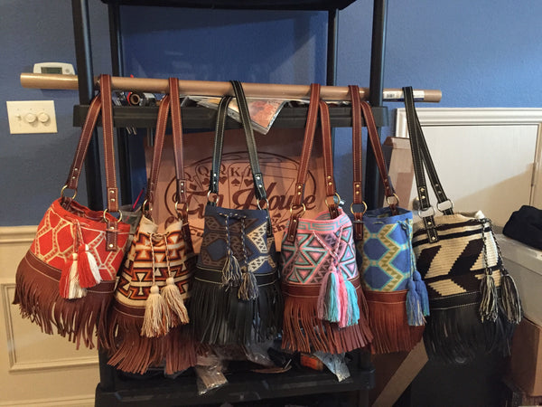 Leather and twill bucket bags with leather fringe