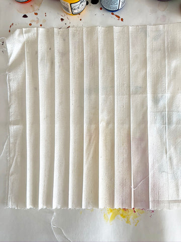 This shibori technique involves binding fabric with stitch before dyeing