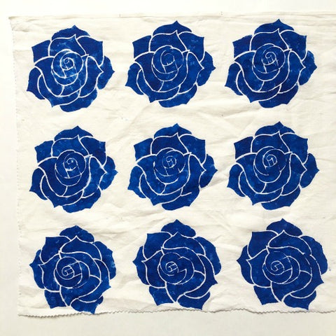 Blue flowers stenciled on fabric | DivineNY.com