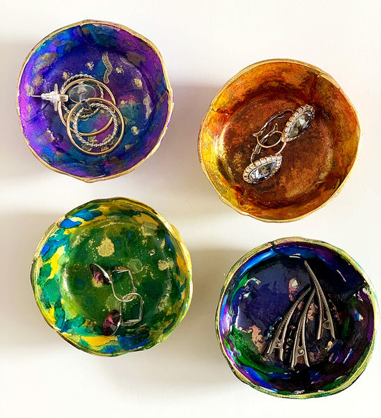 Hand painted with alcohol inks, these ring dishes come as a set of 4 | DivineNY.com