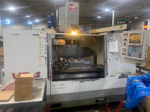 Haas VF-4 Vertical Machining Center, 1999- TSC, 10k Spindle, Auger