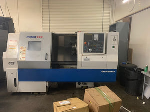 Doosan Puma 240LB CNC Lathe, 2003 - Under Power, Misc Capto Tool Holders, Toolsetter, Chip Conveyor