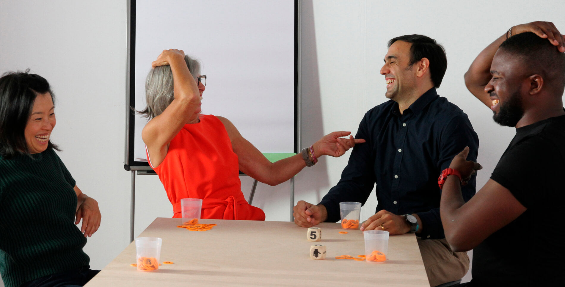 An illustration of people playing SysTeam, a popular hands on team building activity from Metalog Training Tools