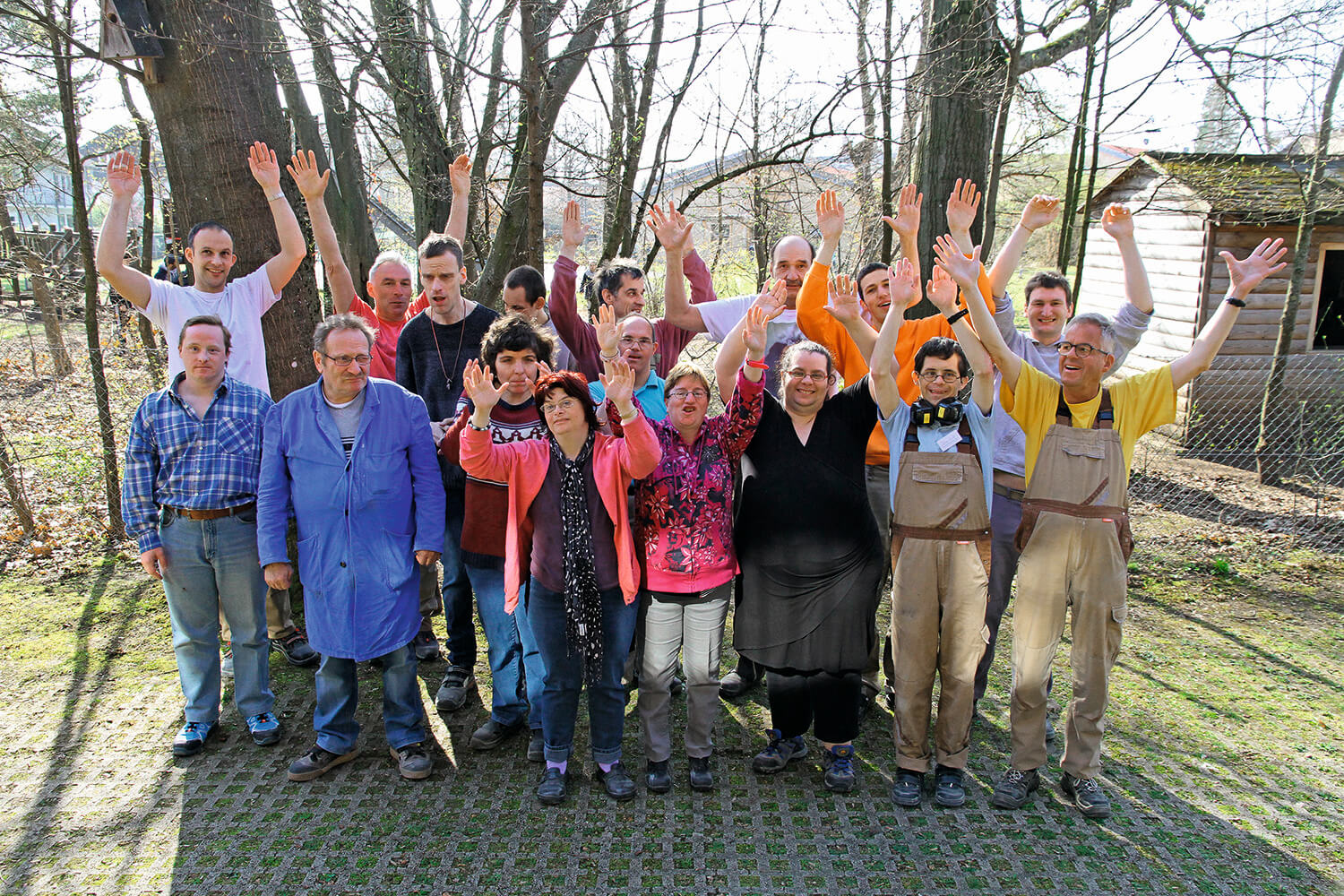 A group of skilled workers with disabilities who work for Metalog Tools to create sustainable training tools stands outside
