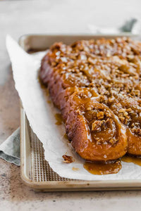 This old-fashioned sticky buns recipe comes complete with a decadent caramel glaze and chopped pecans