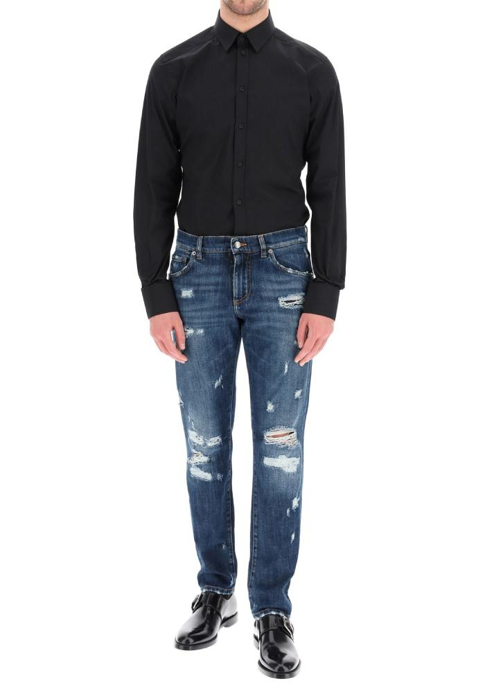 Dolce & Gabbana Embossed Logo Ripped Jeans In Navy