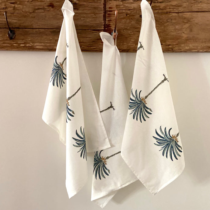 Pretty blue and white palm tree hand block printed tea towels for a boho look