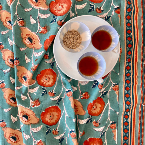 Vibrant teal and orange coloured boho cotton table cloth. Hand block printed in India and fairtrade and sustainable