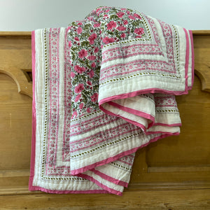 Hand Block Printed Quilt in Bushflower Pink, handcrafted in pure cotton. Fair trade, colourful, sustainable, eco-friendly and ethical for unique decor.