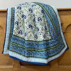 Pretty pan leaf boho bed quilt. Hand block printed in blue, green and grey on white