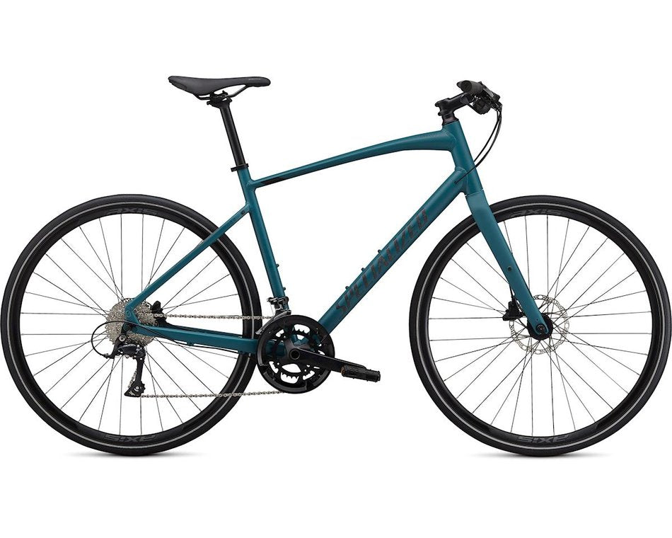 This green colored Specialized fitness bike has hydraulic disc brakes and carbon fork