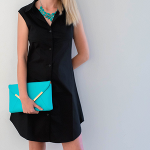 Willow breastfeeding shirt dress accessorised with teal necklace and clutch