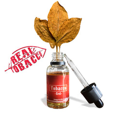red bottle of ejuice with tobacco leaf dripping